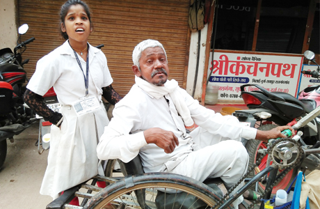 After school she takes her handicapped father to beg for alms